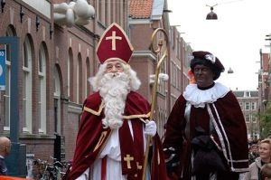 Sinterklaas and Zwarte Piet during an entry parade. Photo: Michell Zappa. Obtained from Wikimedia Commons and used under the  Creative Commons Attribution-Share Alike 2.0 Generic license.
