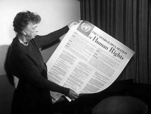 Eleanor Roosevelt, the first chairperson of the UN Human Rights Commission and a driving force behind the drafting of the Universal Declaration of Human Rights, holds the finished document. Courtesy of Wikimedia.