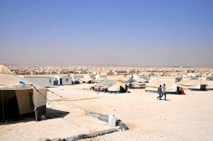 A view of Zaatari refugee camp, Jordan, from August 2013. Source: Foreign and Commonwealth Office, accessed via Wikimedia Commons under  Open Government Licence v1.0