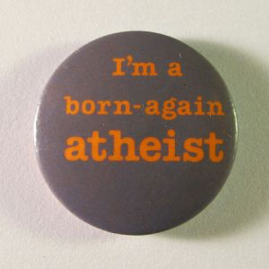 """Born-again atheist badge, c.1987"" by Unknown - Personal collection. Licensed under Public Domain via Wikimedia Commons"