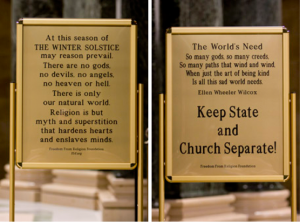 Back and front of a sign put up at the Wisconsin State Capitol by the Freedom From Religion Foundation.