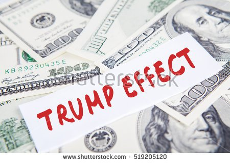 stock-photo-image-of-a-pile-of-dollars-currency-and-text-of-trump-effect-symbolizing-trump-effect-in-american-519205120 (1).jpg